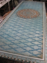A Handpainted Moroccan inspired turquoise table/counter top with silver studs.